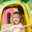 A young girl enjoying a ride on the merry-go-round. — Stock Photo #68053451
