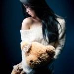 Portrait of a sad asian girl with her Teddy bear — Stock Photo #68211267