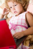Cute little girl using laptop — Stock Photo