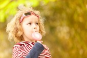 Little girl with lollipop — Stock Photo