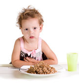 Dissatisfied girl with a big bowl of porridge — Foto de Stock