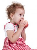 Little Girl Eating Fruit. Isolated on White — Stock Photo