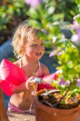 Cute blonde gardening on sunny day — Stock Photo