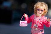 Portrait of a little girl with little bag. — Stock Photo
