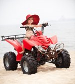 Young girl riding a quadbike — Stock Photo