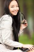 Portrait of a beautiful young asian woman with glasses. — Stock Photo