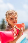 Cute little girl eating water-melon in summertime — Stock Photo