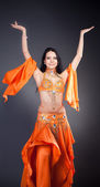 Belly Dance Performance. Grey background. — Stok fotoğraf