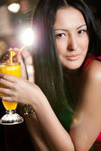 Beautiful asian girl with a cocktail — Stock Photo