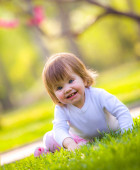 Smiling little girl on a meadow — Stock Photo