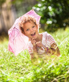 Little girl playing with umbrella — Stock Photo