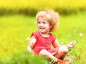 Cute little girl with dandelion — Stock Photo