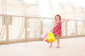 Young girl with full of bags — Stock Photo