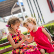 Two happy little girls with lollipops outdoors — Stock Photo #71987699