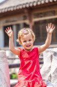 Beautiful excited little girl hold hands — Stock Photo