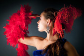 Young woman and red feathers — Stock Photo