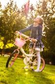 Young girl enjoying her bike. — Stock Photo