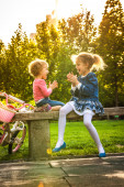 Cute little baby playing pat-a-cake with her sister — Stock Photo