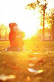 Cute girl walk in the rays of the autumn sun — Stock Photo
