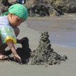Boy builds a sand castle — Stock Photo #57516203