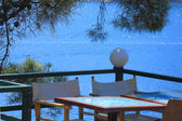 Table in a cafe by the sea — Stock Photo