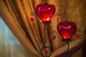 Lights in candelabras with hearts shape — Stock Photo