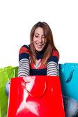Junge Frau Eröffnung Einkaufstaschen — Stockfoto