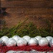 White christmas balls  and red beads with wooden background — Stock Photo #58823617