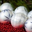 White christmas balls  and red beads with wooden background — Stock Photo #58823643
