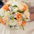 Pastel wedding bouquet with orange roses in hands — Stock Photo #59285495