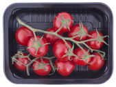 Cherry tomatoes in a container — Stock Photo