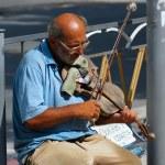Постер, плакат: Old musician playing the violin