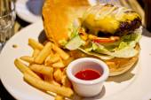 Traditional american burger, freshly french fries — Stock Photo