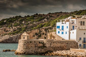 Home on water's edge in Ibiza — Stock Photo