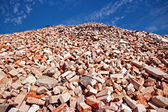 Pile of bricks in recycling site — Stockfoto