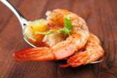 Shrimps on spoon — Stock Photo