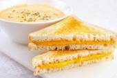 Cheese sandwiches with a bowl of soup — Stock Photo