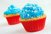 Two cupcakes with blue icing — Stock Photo