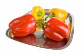 Red and yellow paprikas — Stock Photo