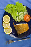 Smoked whitefish on the dish — Stock Photo