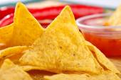 Nacho snacks with salsa dip — Stock Photo