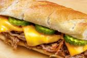 Pulled pork baguette sandwich with cheese — Stock Photo