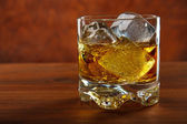 Whiskey on the rocks on wooden table — Stock Photo