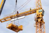 Tower crane in the construction site — Stock Photo