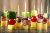 Cocktail sticks with cheese — Stock Photo