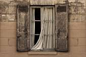 Old vintage window with open brown blinds and old used bricks. — Stock Photo