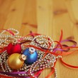 Three multi-colored New Year's balls on brilliant garlands — Stock Photo #56859359