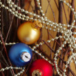 Three multi-colored New Year's balls on brilliant garlands — Stock Photo #56859451