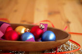 Multi-colored New Year's toys on bright brilliant jewelry — Stock Photo
