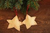 Christmas decorative asterisks on a wooden background — Stock Photo